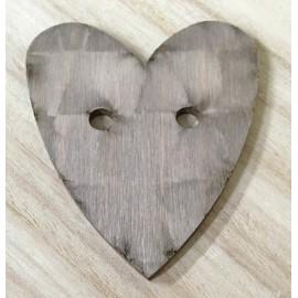 Base di legno a forma di cuore con buchi