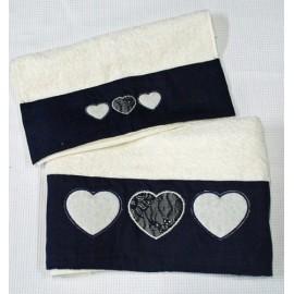 Coppia di asciugamani ricamati