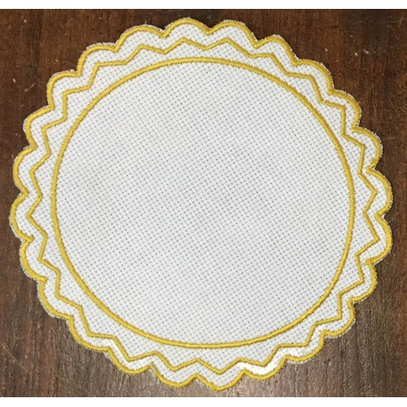 Round 2 in the Aida fabric - col. White contours in ochre