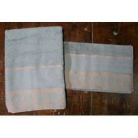 Couple bath towels with border flowers with. Pewter