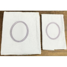 Couple bath towels with. White and plural